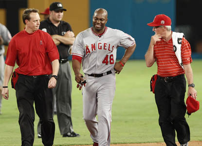 Torii Hunter leaves the game after crashing into the wall in the fifth inning. (AP)