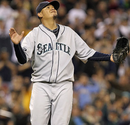 Felix Hernandez feels just at home Friday night because he is at home. He strikes out 10 while earning the win for Seattle.  (Getty Images)