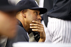 Derek Jeter watches from the dugout during a recent game. The Yankee captain remains on the DL with a calf strain. (Getty Images)
