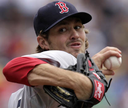 Andrew Miller allows just one earned run for Boston, winning his first game in a Red Sox uniform. (AP)