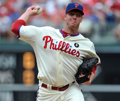 Roy Halladay gives up eight hits and strikes out four on his way to win No.  10. (Getty Images)