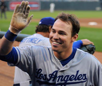 After a tough day in Dodgers history, its all smiles for Trent Oeltjen, who homered in L.A.'s 15-0 win. (AP)