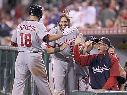 New Nationals manager Davey Johnson greets Danny Espinosa after his game-tying home run in the ninth inning.  (Getty Images)