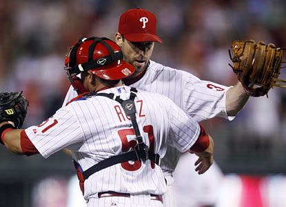 Carlos Ruiz congratulates Cliff Lee, who racks up his fourth shutout of the season and ninth of his career.  (AP)