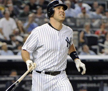 Mark Teixeira homers in the sixth inning for New York.  Teixeira finishes with four RBI in the win. (AP)