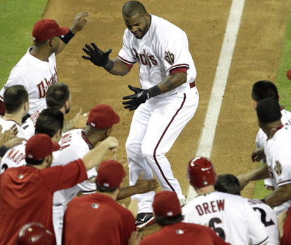 Wily Mo Pena joins the celebration at home plate, after his walk-off homer beats the Indians. (AP)