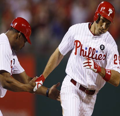 Raul Ibanez rounds the bases after hitting a solo shot that wins the game for the Phillies. (AP)