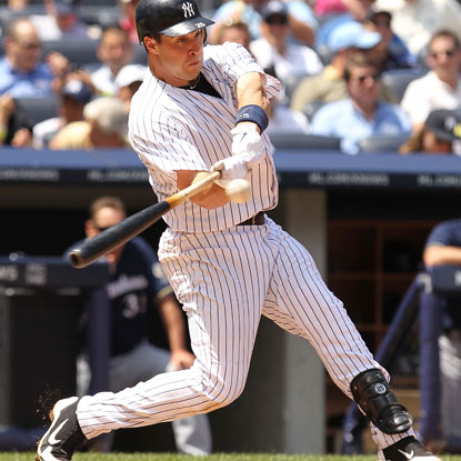 Mark Teixeira drives it out of the park for the 25th time this season to reach the 300-homer plateau for his career. (Getty Images)
