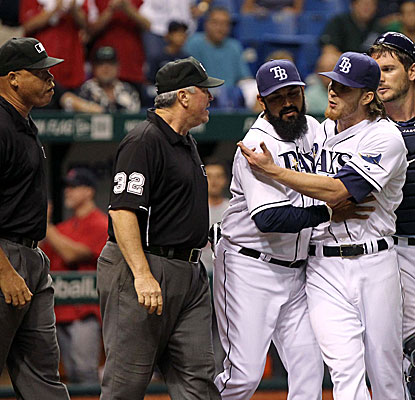 Rays reliever J.P. Howell spikes his glove and baseball on the ground after giving up a home run, earning him an ejection.  (US Presswire)