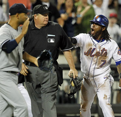 Jose Reyes does not agree with the umpire after he is called out on a controversial play at third base.  (US Presswire)