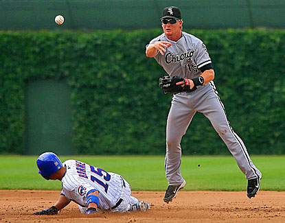 Gordon Beckham (right) forces out the Cubs' Darwin Barney on the front end of a double play in the third inning. (US Presswire)