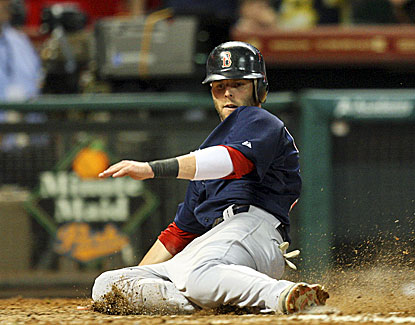 Boston's Dustin Pedroia, who goes 3 for 5 against the Astros, scores in the seventh inning. (Getty Images)