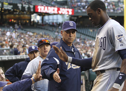 The Padres' Cameron Maybin (right) gets a three-ball walk and winds up scoring the only run of the game. (Getty Images)