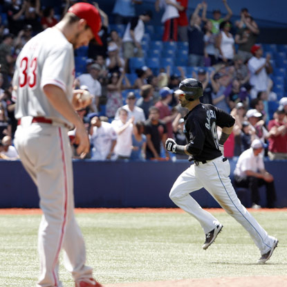 Jose Bautista chalks up his major-league leading 27th HR at the expense of Cliff Lee and the Phillies.  (Getty Images)
