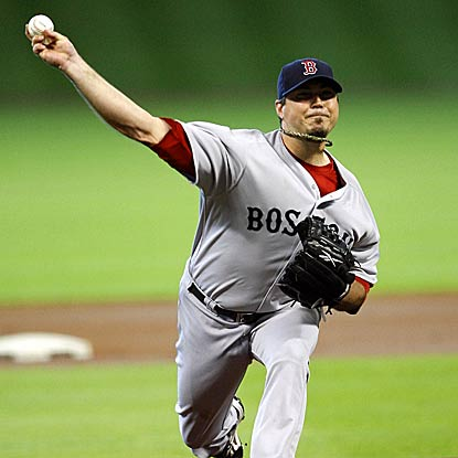 Boston's Josh Beckett records another strong victory, striking out a season-high 11 batters in eight innings. (Getty Images)