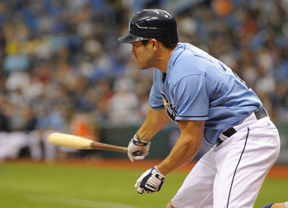 Johnny Damon awkwardly swings through a bases-loaded triple before finishing the game with four RBI. (Getty Images)