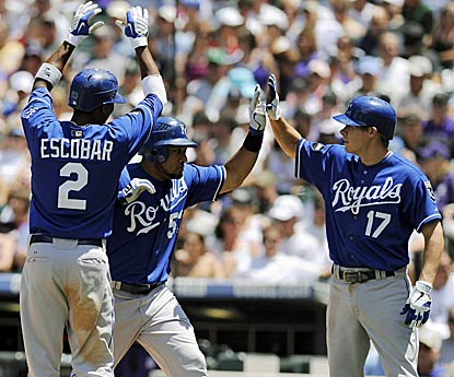 Melky Cabrera (center) knocks two home runs and five RBI and the Royals tie a team record with 12 extra-base hits. (AP)