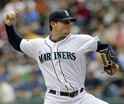 Mariners pitcher Blake Beavan delivers in his debut by scattering three hits over seven innings and striking out four. (AP)
