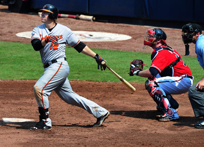 Mark Reynolds sends a two-run shot over the wall in the seventh to help give the Orioles a win. (Getty Images)