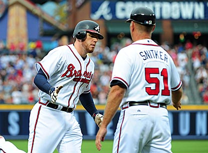 Freddie Freeman hits a two-run homer in the first inning and adds a solo shot in the eighth inning.  (Getty Images)