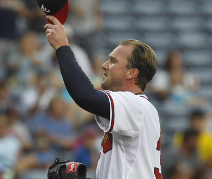 Derek Lowe tips his cap after recording his 1,600th career strikeout in the second inning. (AP)