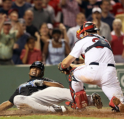 Edwin Encarnacion is called out at home plate for the final out of the game, preserving a Boston victory. (Getty Images)