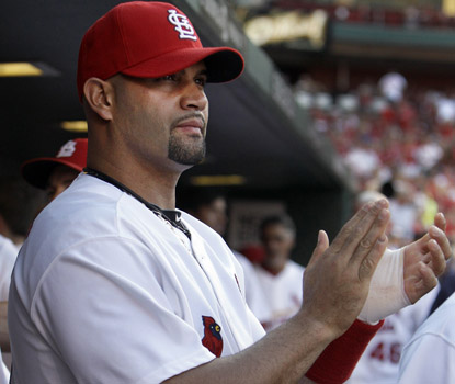 Albert Pujols doesn't play in his first game back from the DL as the Cards romp over Cincy. (AP)