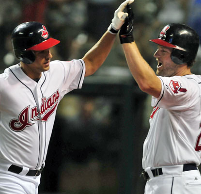 Indians rookie Lonnie Chisenhall (left) slams his first major-league home run in the seventh inning.  (Getty Images)