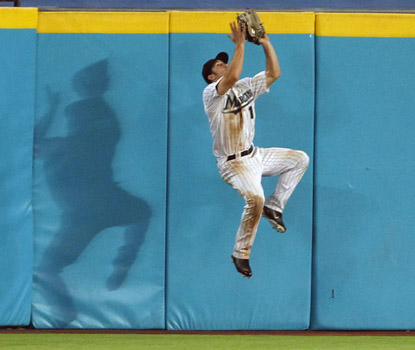 Marlins center fielder Bryan Petersen nabs a drive by Ryan Howard at the wall in Florida's win. (AP)