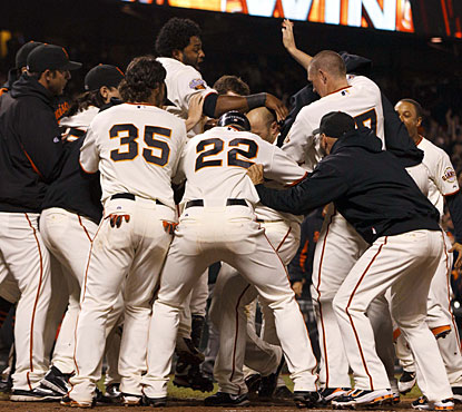 Giants players jump for joy around Nate Schierholtz, whose second home run of the game is the winner. (US Presswire)