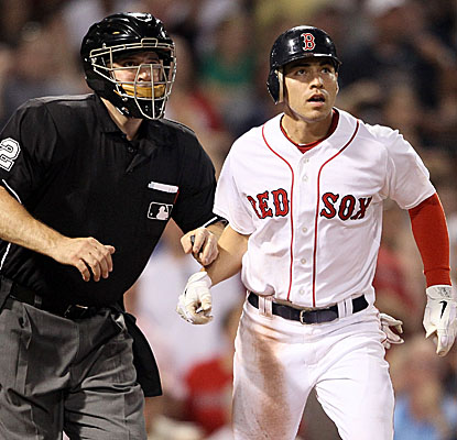 Jacoby Ellsbury and home plate umpire Bill Welke watch the center-fielder's fly ball sail over the fence in the sixth inning. (Getty Images)