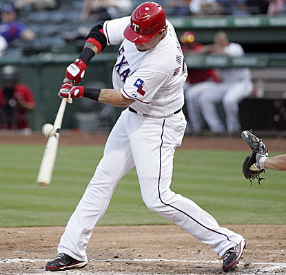 Josh Hamilton drives in a run in each of his first four at-bats as the Rangers blank the A's. (Getty Images)