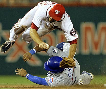 Chicago center fielder Marlon Byrd breaks up a crucial double play to position the Cubs for a come-from-behind win. (AP)