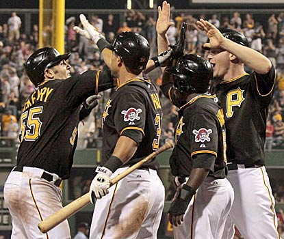 The Pirates secure their first winning record before the All-Star break in 19 years on a three-run shot by rookie Mike McKenry. (AP)