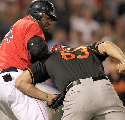 David Ortiz does battle with Orioles reliever Kevin Gregg, setting off a bench-clearing fracas in the eighth inning.  (Getty Images)