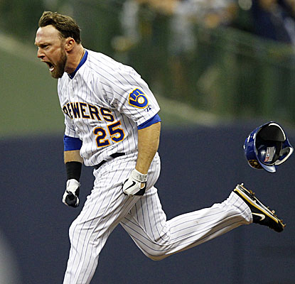 Mark Kotsay drives in Milwaukee's final four runs, the last two coming in the ninth to provide the winning margin.  (AP)