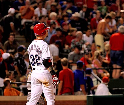 Josh Hamilton has another emotional day as he looks on with concern after his foul ball strikes a fan. (US Presswire)