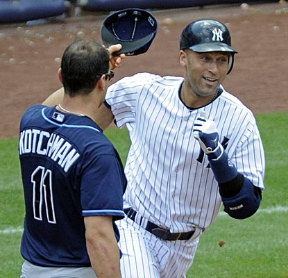 Yankees captain Derek Jeter homers for hit number 3,000. He also finishes the game in style by going 5 for 5. (AP)