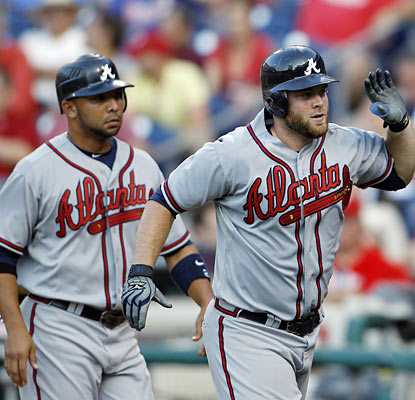 Alex Gonzalez and Brian McCann fuel Atlanta to victory and help cut Philly's NL East lead down to 2 1/2 games. (AP)