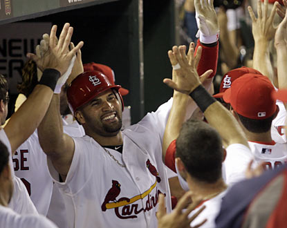 Albert Pujols ties things up for St. Louis after he blasts a home run in the eighth -- his first dinger (AP)