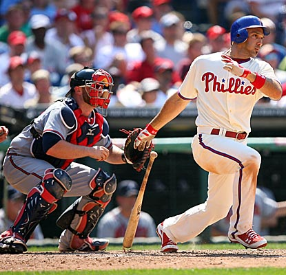 Raul Ibanez connects for a two-run single as the Phillies collect a season-high 20 hits against Atlanta. (Getty Images)