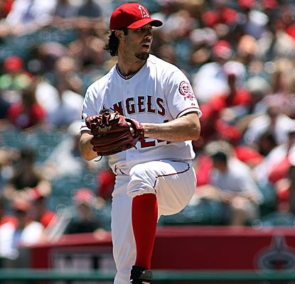 Dan Haren nearly completes his second straight game, pitching into the ninth and striking out eight in the Angels' home win. (Getty Images)