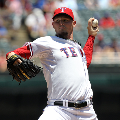 Matt Harrison pitches six-hit ball into the eighth inning while leading the Rangers to a shutout victory over the A's.  (Getty Images)