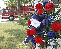 Wreaths and flowers rest outside the Central Fire Station in Brownwood in memory of firefighter Shannon Stone. (AP)