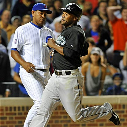 Marlins pinch-runner Dewanye Wise scores after Cubs closer Carlos Marmol blows his seventh save of the season. (Getty Images)