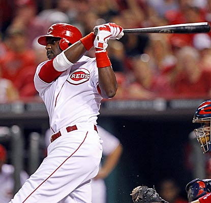 The Reds' Brandon Phillips swings through a walk-off shot in the ninth against the Cardinals' Fernando Salas.  (Getty Images)