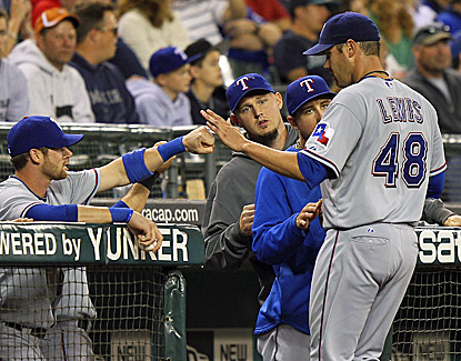 Colby Lewis is congratulated after shutting down the M's, throwing 8 2/3 innings and falling one out shy of a complete game. (Getty Images)