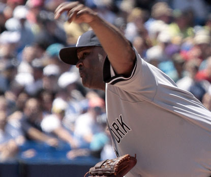 CC Sabathia's streak of 23 2/3 scoreless is snapped, but he still wins his major-league best 14th game. (Getty Images)