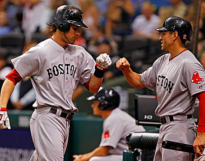 Josh Reddick is congratulated by Jacoby Ellsbury after his two-run home run against the Rays. (Getty Images)