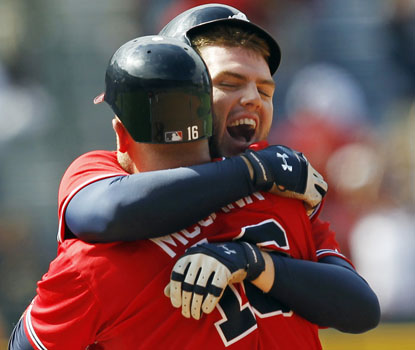 Freddie Freeman celebrates his game-winning hit with Brian McCann, as Atlanta pulls out a dramatic comeback. (AP)